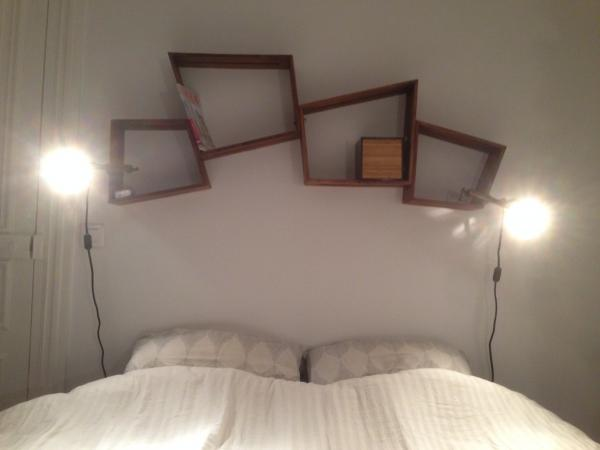 2 pairs of Stockholm box shelves above our bed, very elegant and handy! We would have loved to add another pair if we had more room