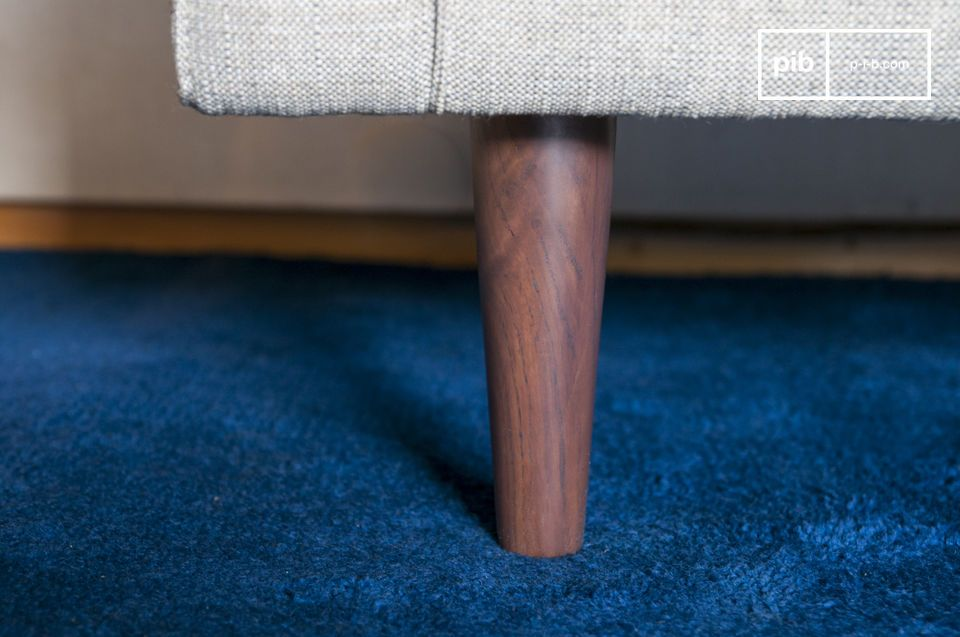 It displays multiple right angles, softened by round armrests