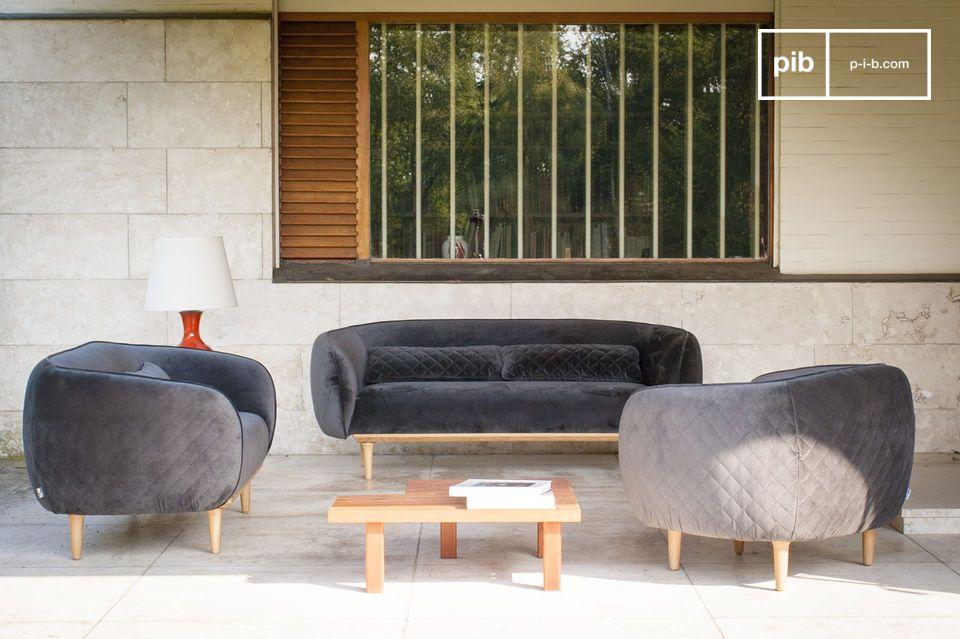 A grey velvet sofa with an original design