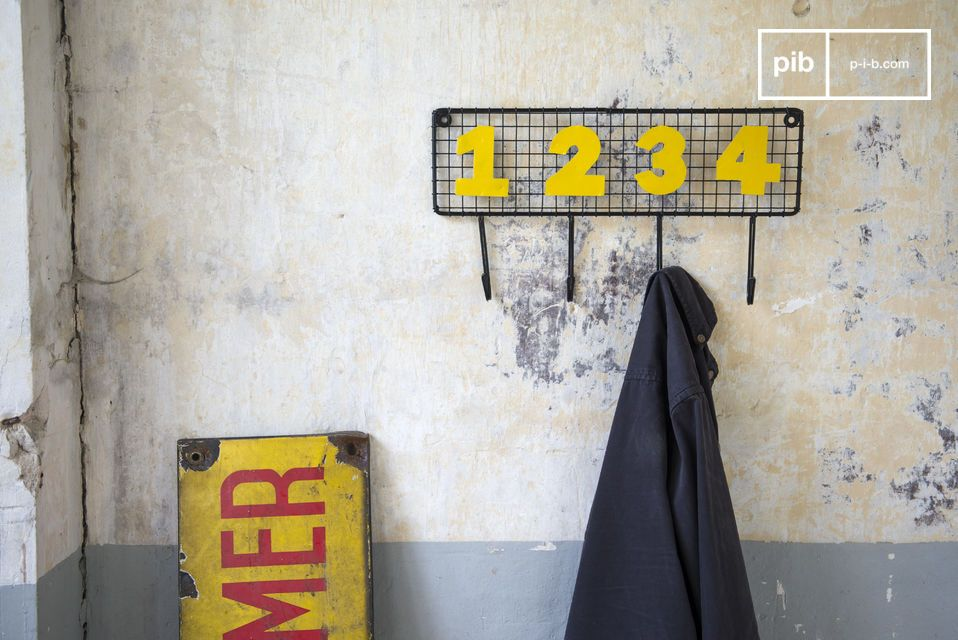 Vintage mesh coat rack with numbered hooks.
