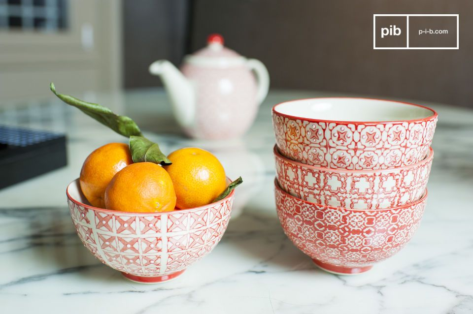 Four bowls with geometric patterns of a bright red.