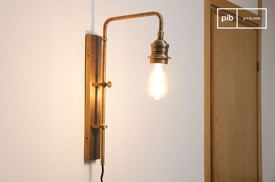 Wall lamp made of brass with retro charm.