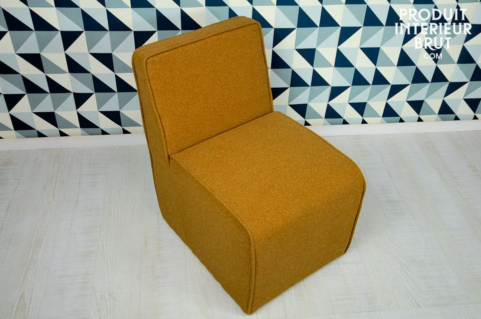 You will love sitting on this soft cushiony chair with its vintage lines