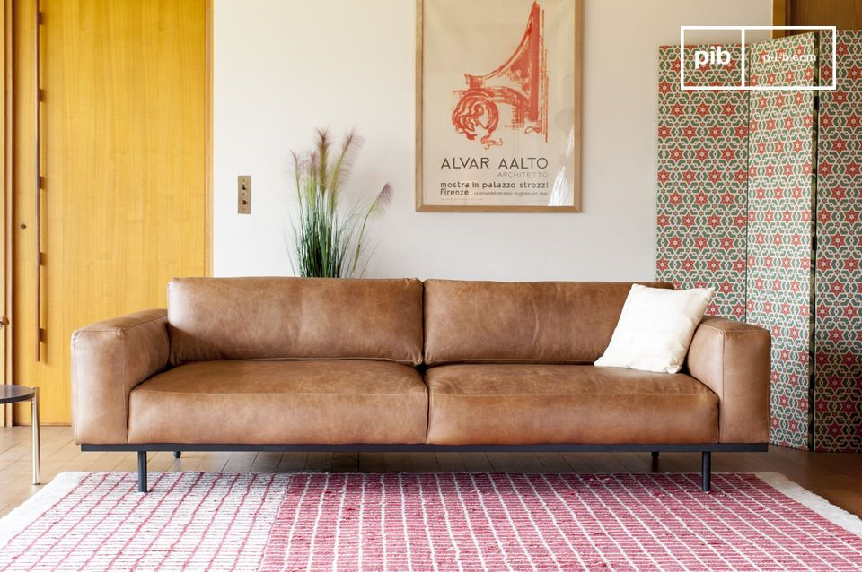A sofa with a harmonious design, elegantly supported by a metal structure.