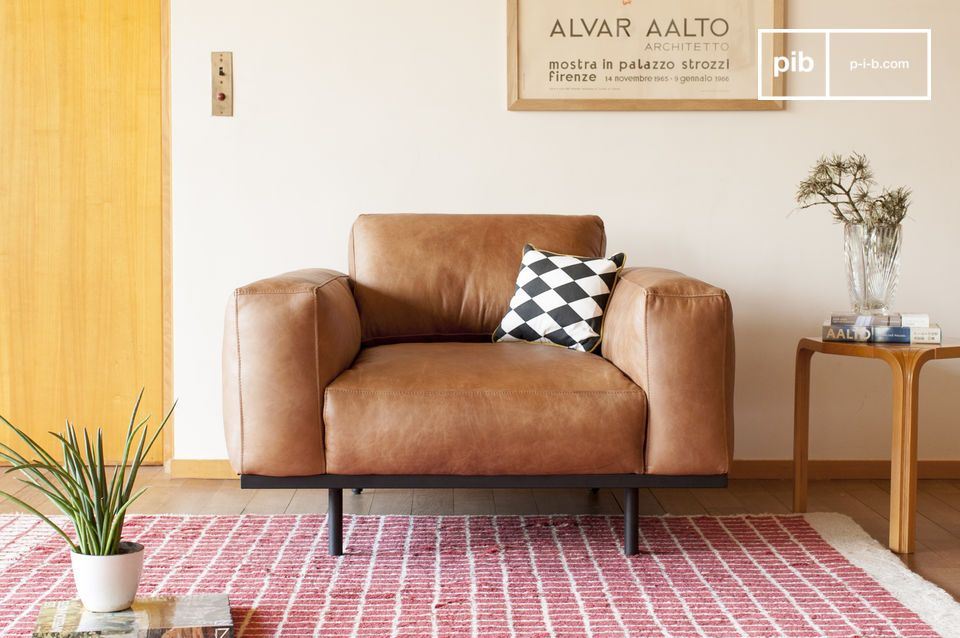 Almond armchair in brown leather