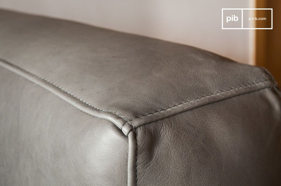 The grey is very slightly shaded and the leather is of a rare quality.