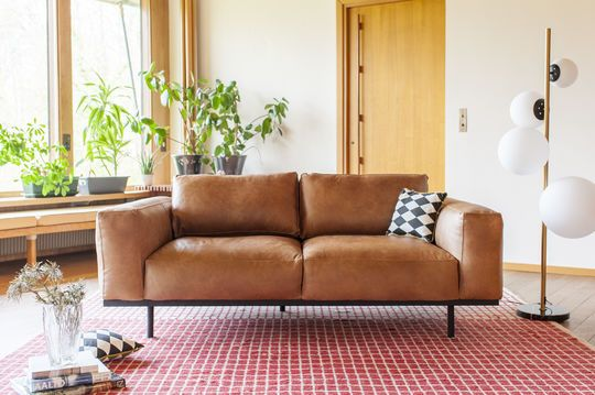 Almond sofa in brown leather