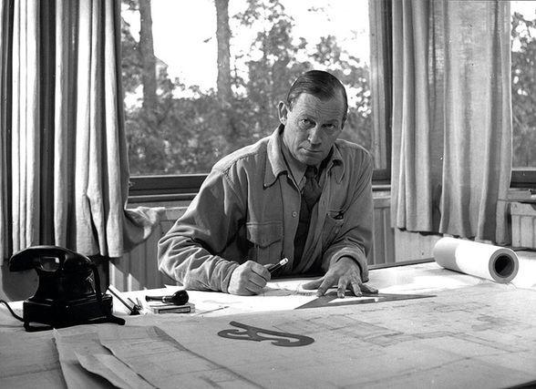 Alvar Aalto behind his desk