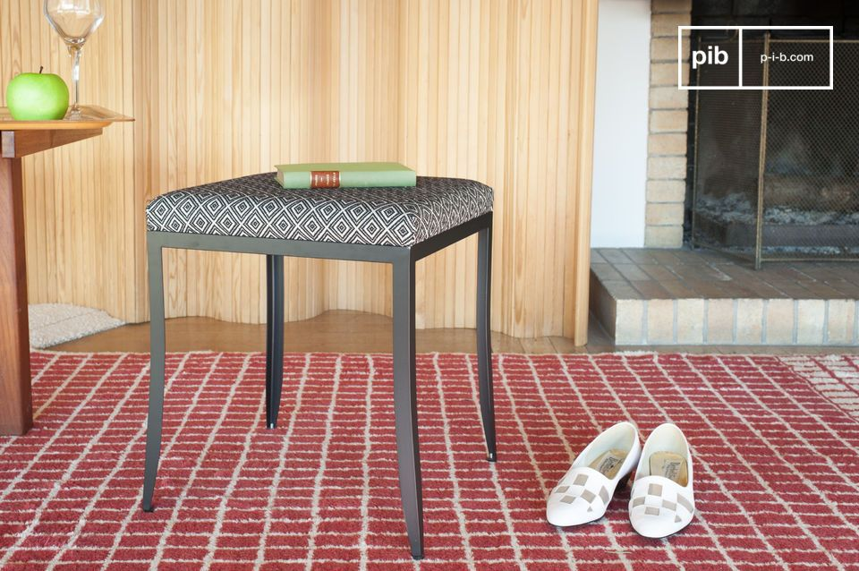 Elegant stool with geometric patterns and sleek lines.