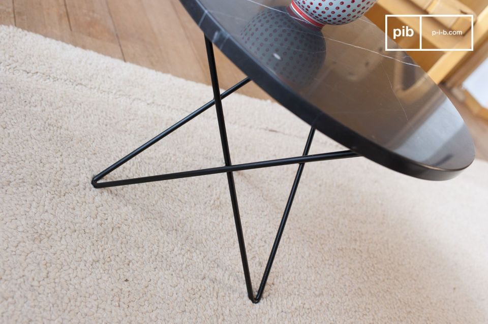 The Aouthenn side table has a thick black marble top