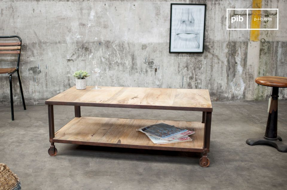 Table with two shelves on steel structure. Undeniably industrial.