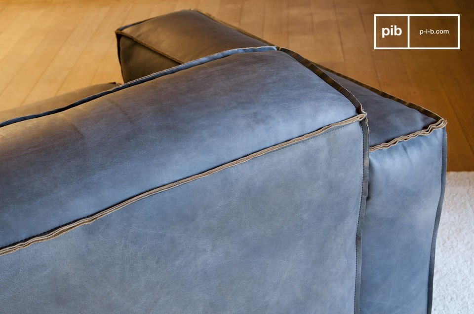 The leather used is full grain and has been dyed to give the armchair a brownish grey shade and