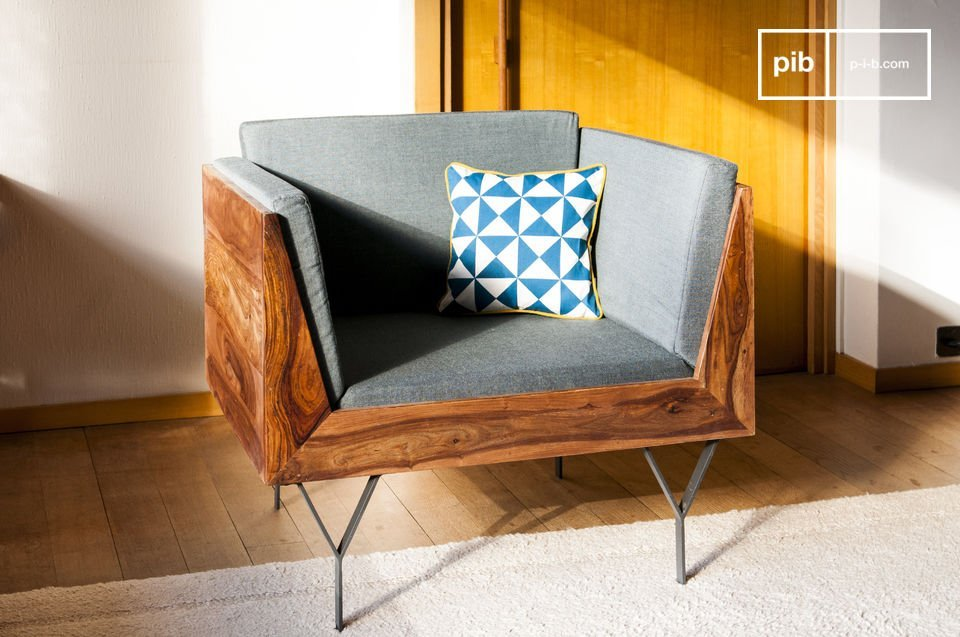 The structure of this retro armchair is made out of varnished sheesham wood