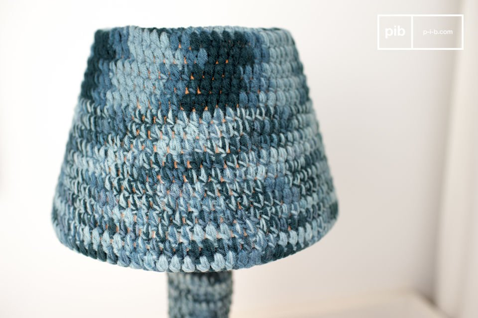 The lamp is entirely covered in hand-hooked textile.