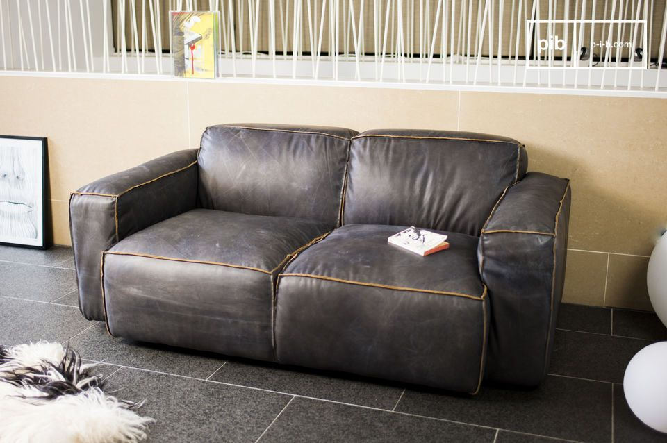 One of the defining aspects of the sofa are its seams which are roughly stitched together to expose the inside side of the leather at every corner and angle of the sofa