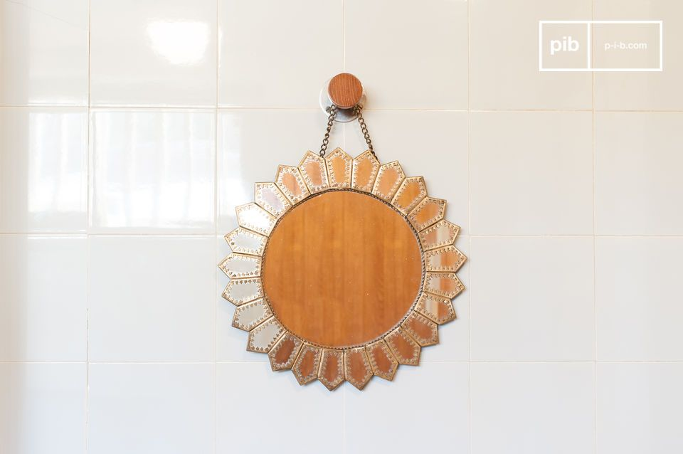 A beautiful Moorish-inspired sun-shaped mirror