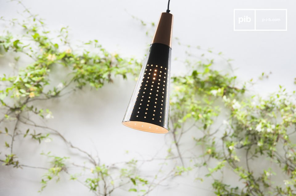 The pendant light Balero consists entirely of metal and impresses the viewer through its conical structure and the copper-colored finishing