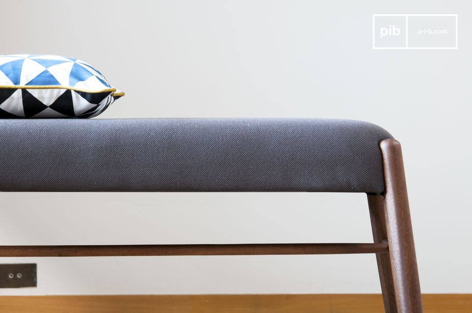A comfortable bench which can be positioned along a dining table