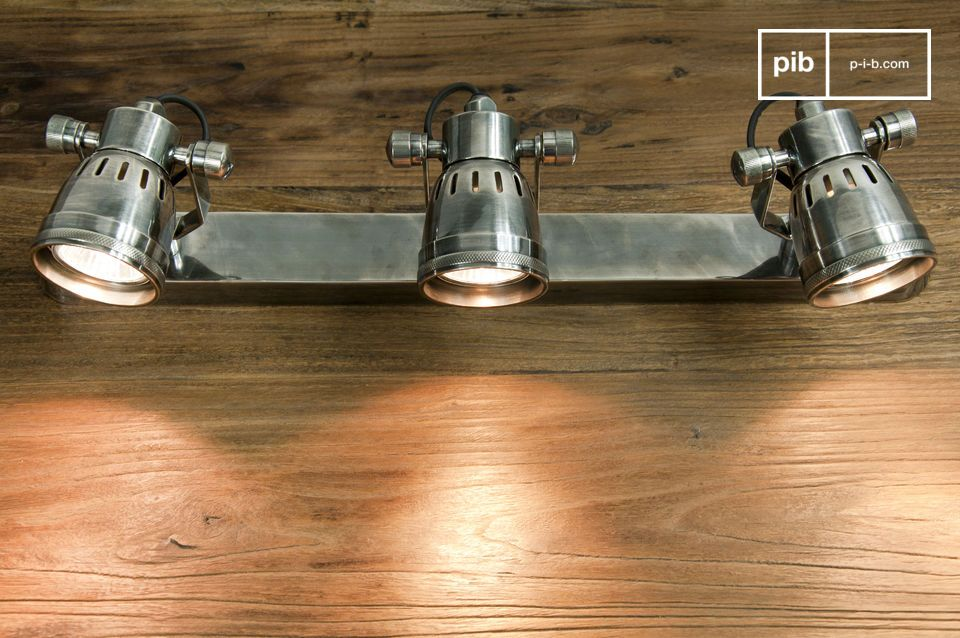 Made entirely of silver-plated brass, this triple lamp wall light has a vintage style of its own