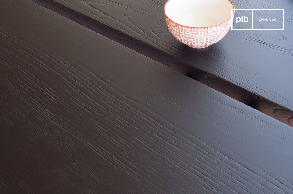 The Osaka dining table has a thick, stained ash top with a black varnished finish