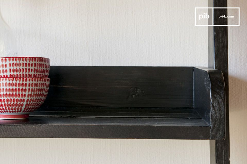 A library highlighting the charm of recycled old wood: the black wooden large scale bookcase is made