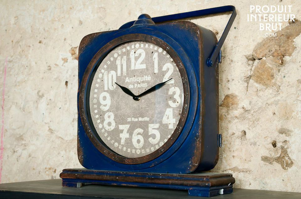 This free standing metal clock has a distressed dark blue finish that will give vintage style cachet
