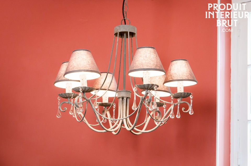 This chandelier mixes elegance and lightness with its curved lines and glass gobs which light up the