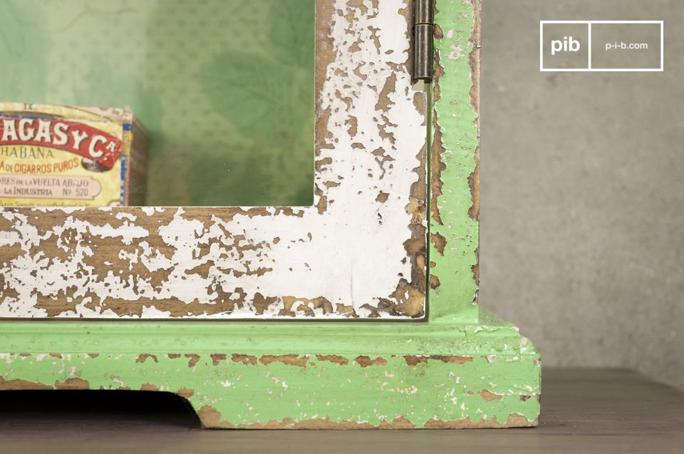 The floral pattern of the wallpaper back to these rustic shelves and its hand-distressed paint