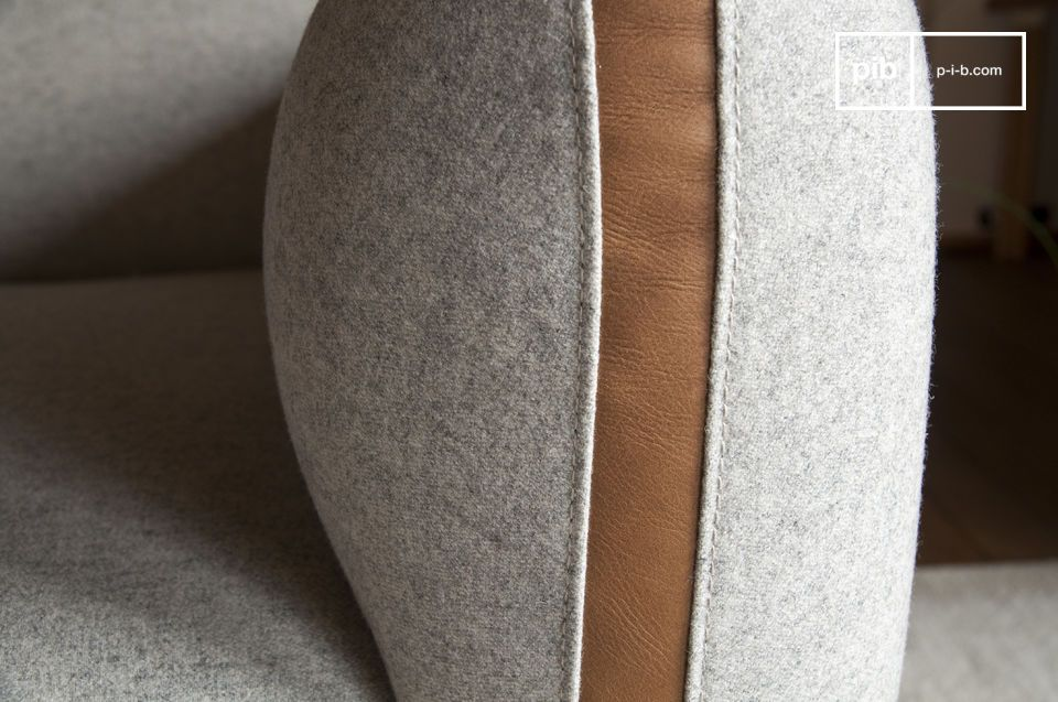 This light gray armchair adopts a \