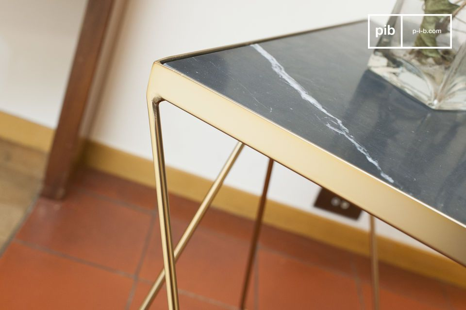 The square top of the small Bumcello table is made of ribbed green marble