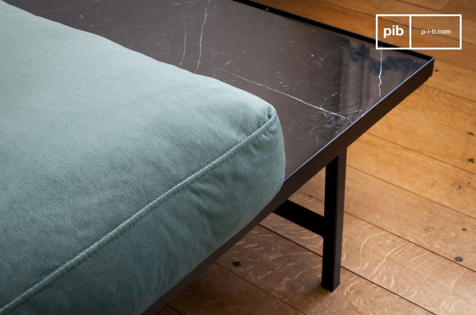 Combining a black ribbed marble top with 6 thin metal legs