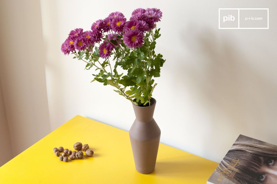 The vase is made of a beautiful ceramic material.