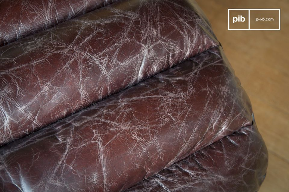 The foam mattress is covered with slightly aged leather with a brown colour that tends slightly