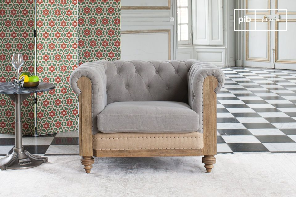 An armchair with a grey vintage style, revisited in a modern way