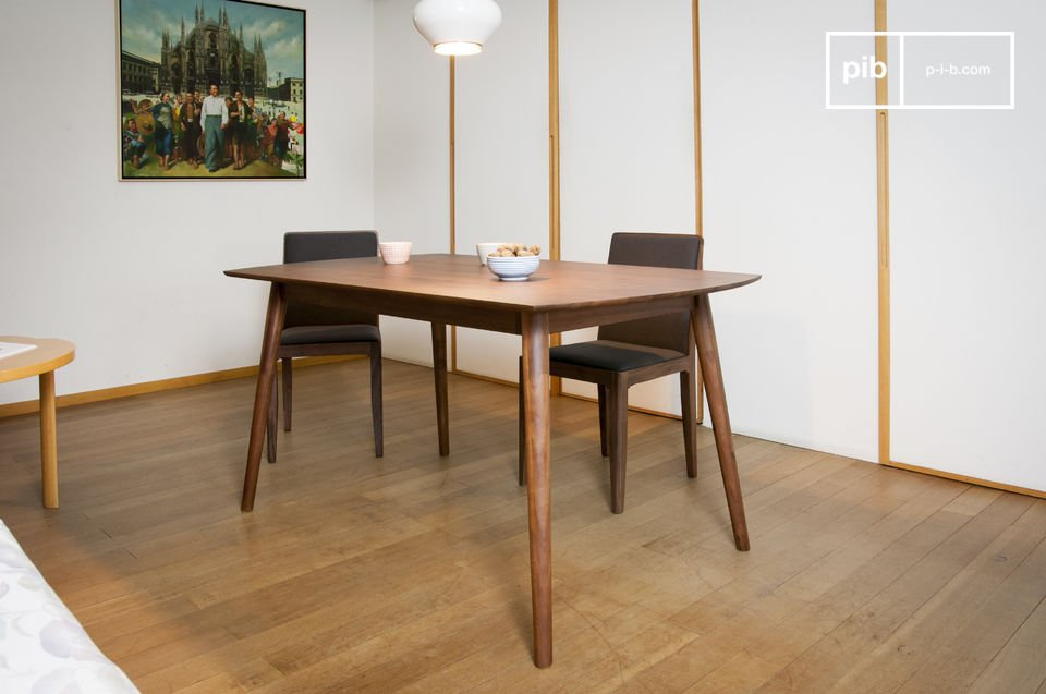 Beautiful dark wooden dining table with compass legs.