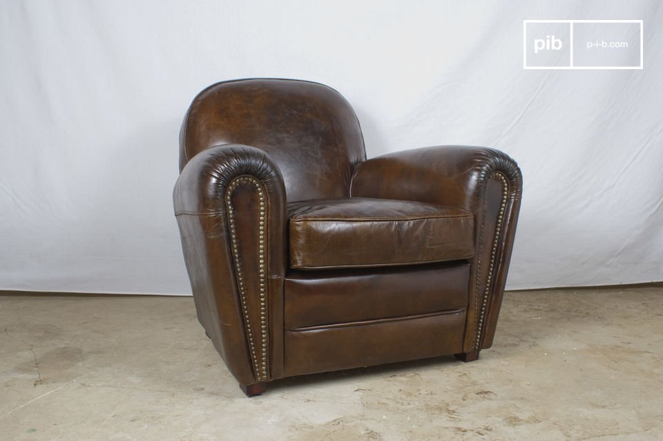 This typical English gentlemen\'s club strong leather armchair is made of aged pigmented leather