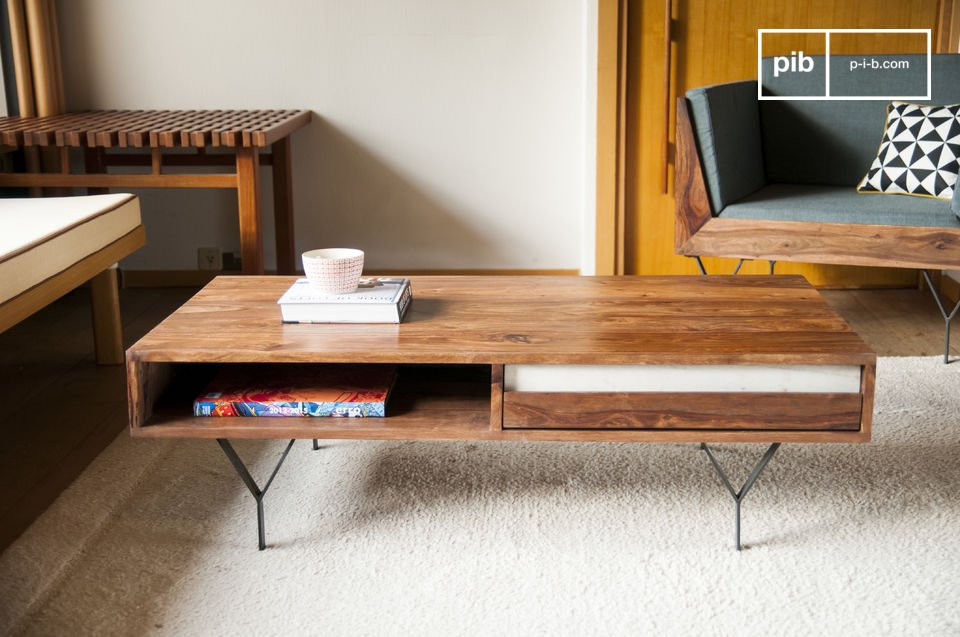 Metal feet and a touch of white marble that contrasts with the dark wood gives this coffee table a
