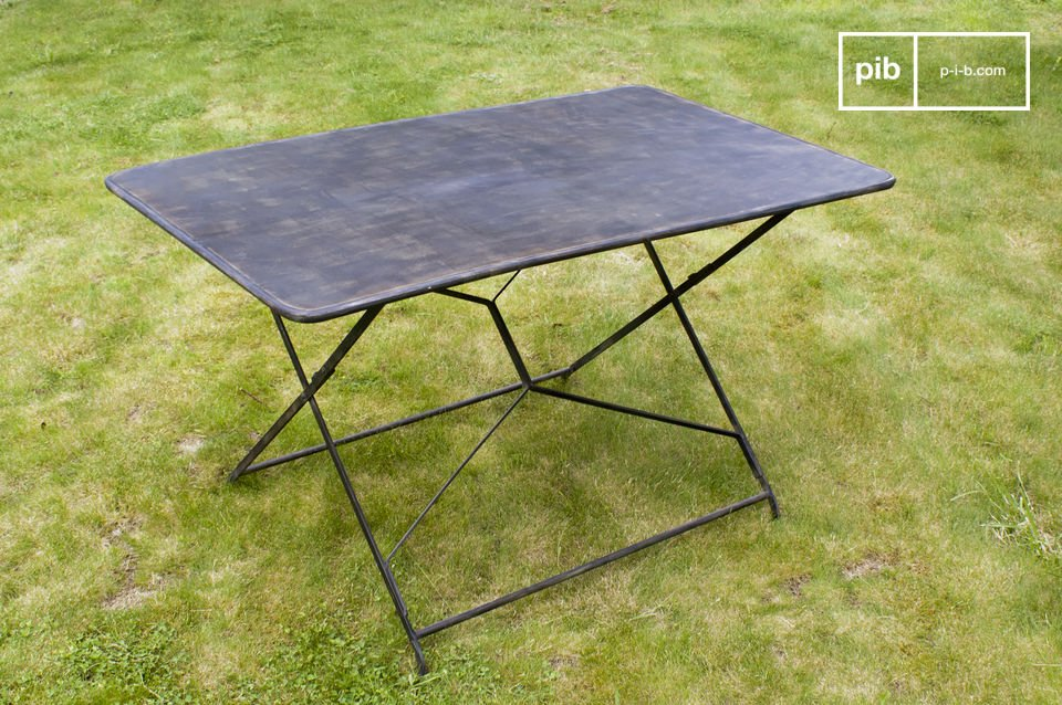Choose this table which has definite retro cachet thanks to its layered paint distressed finish