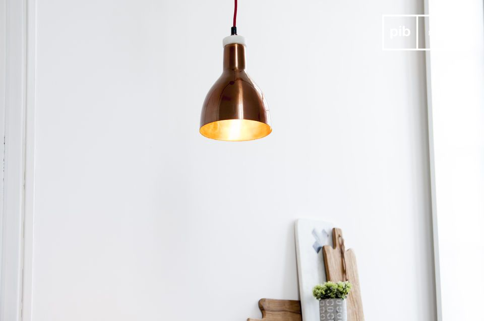 A small pendant lamp combining marble and copper
