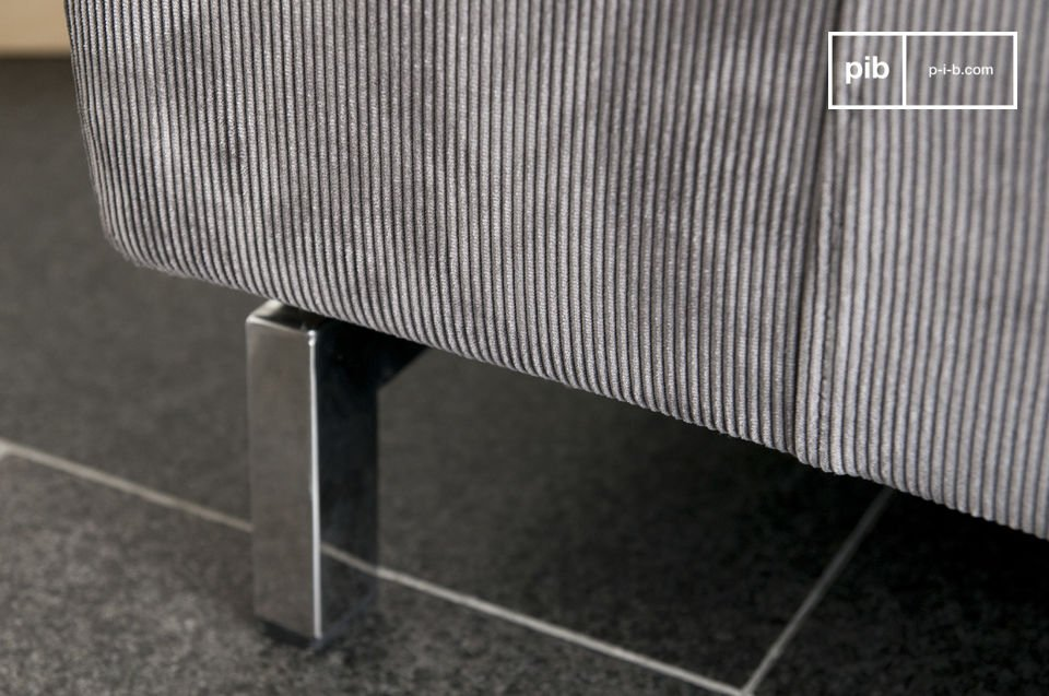 A sofa with style made of corduroy that comes in a 60s design and chrome base