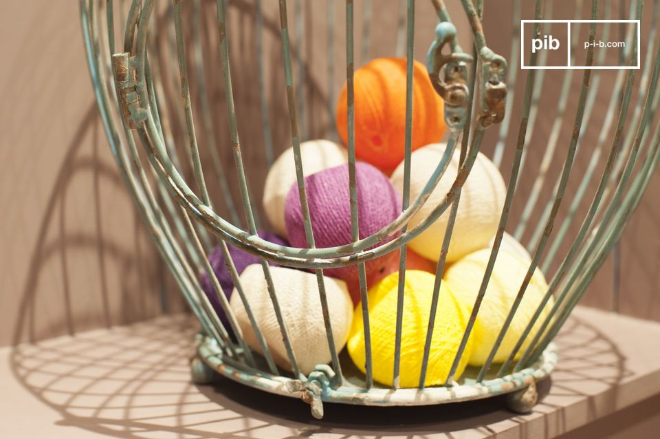Add a natural retro flair to your interior with this charming and antique cage