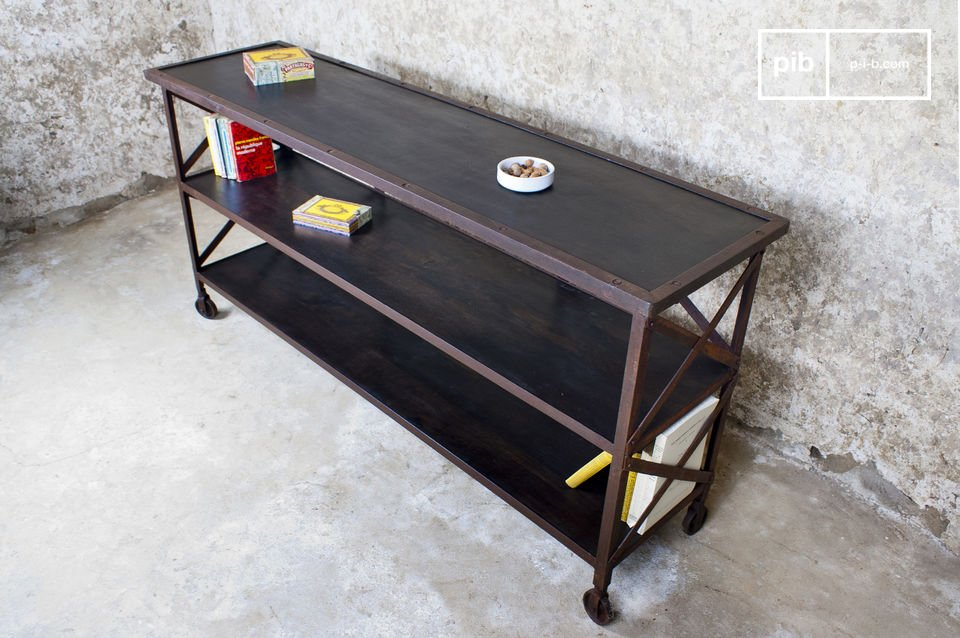 This console\'s distressed rust-coloured structure and wheels give it an unmistakeable workshop look