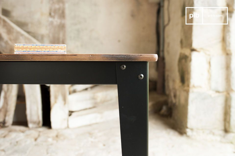 The tabletop of the table Doinel is made of birchwood that has been patinated and varnished