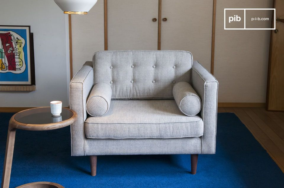 Elegant armchair in light grey mottled fabric with a vintage spirit.