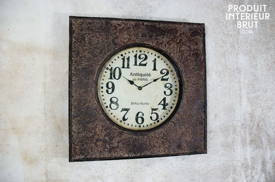 This metal clock has a fine textured and distressed finish