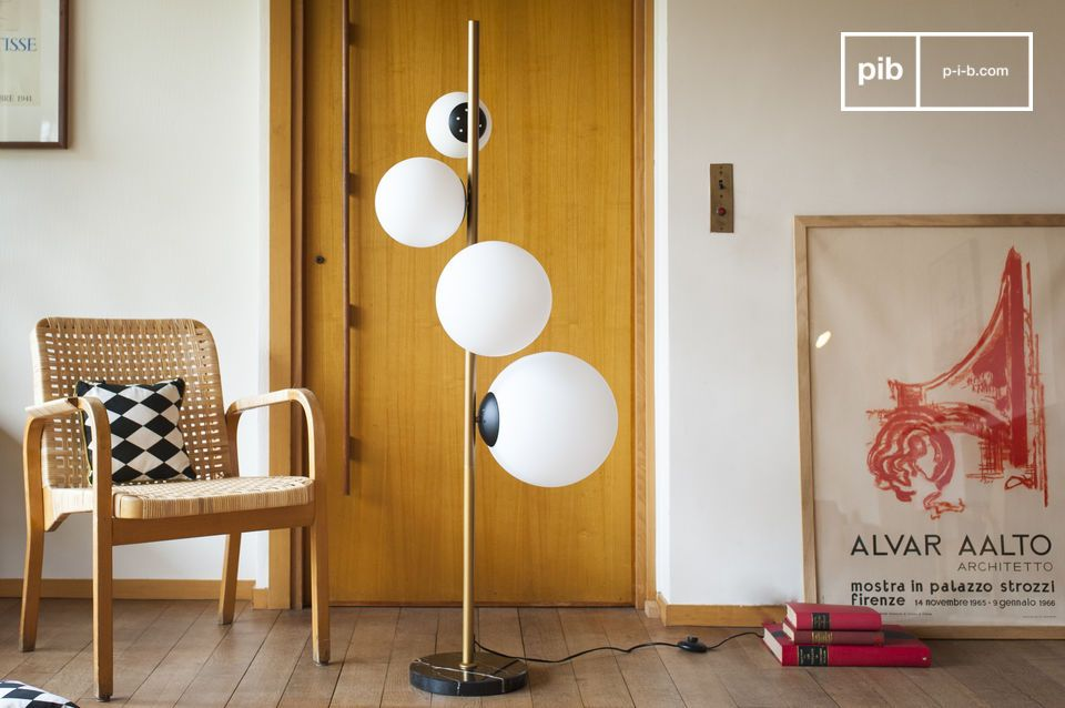 The Canaveral floor lamp immediately recalls the creative worlds of the 1960s and 1970s with the
