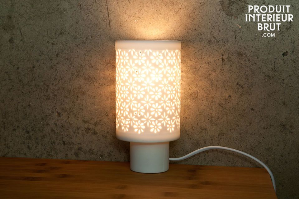 This Nordic design table lamp is completely white and made of translucid porcelain
