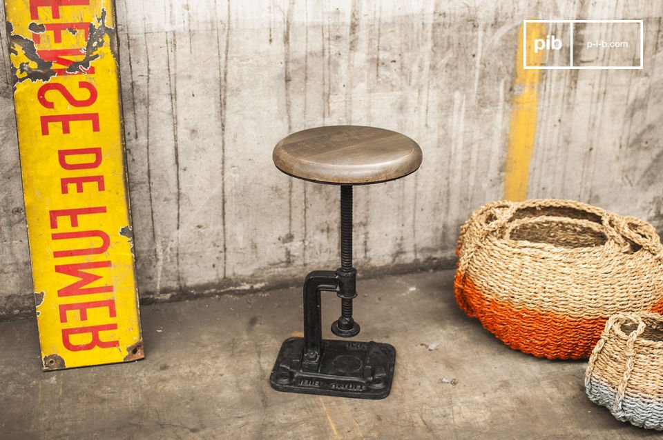 The base of this stool is unique as it comes in the form of a vice clamp