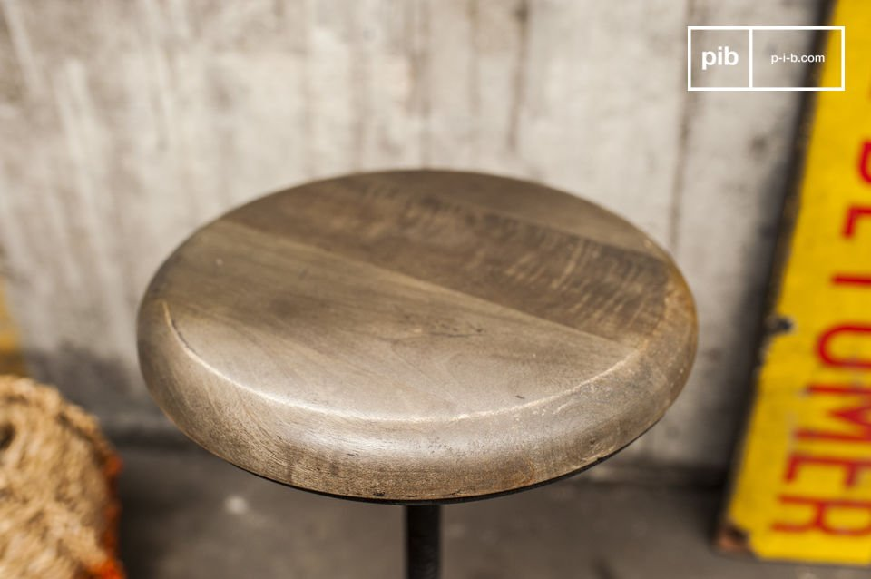 An industrial stool, made entirely of cast metal and wood