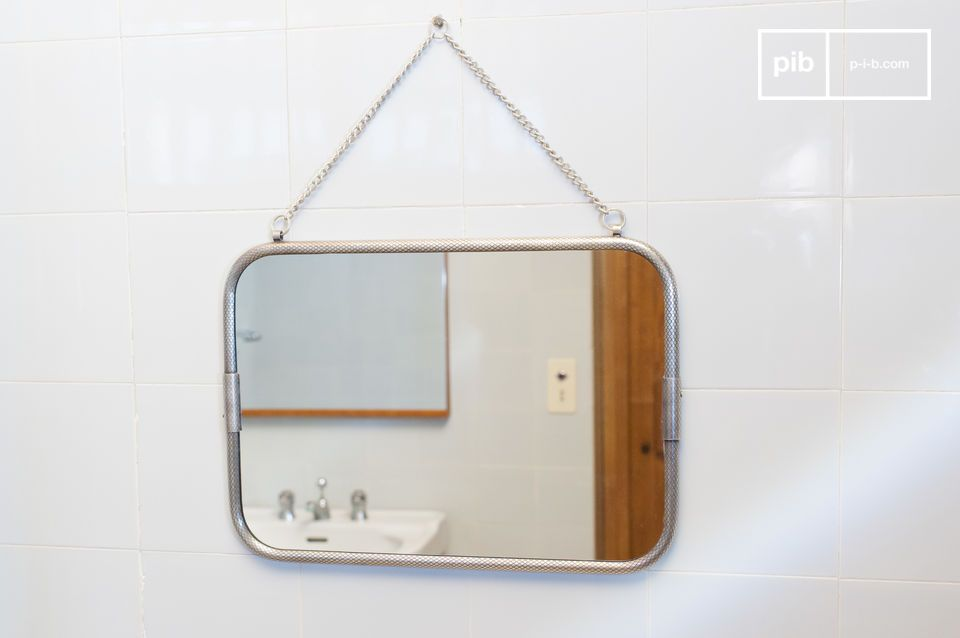 Retro style wall mirror with chain.